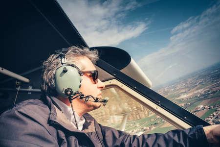 airplane ultralight: Pilot of ultralight aircraft in flight