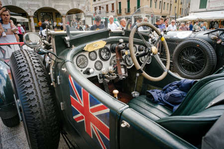 grappa: Bassano del Grappa, Vicenza ITALY - June 21, 2015. Vintage cars in Freedom Square in Bassano del Grappa, VI - ITALY. The cars and Their crews took part in the competition The Mythical Sports Bassano.