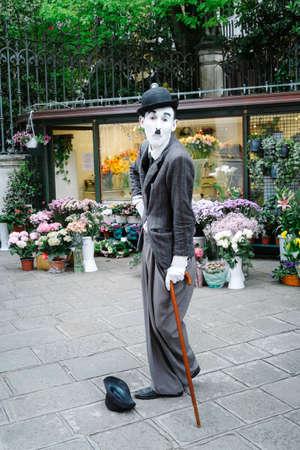 chaplin: Venice, Italy - April 13, 2016: street artist imitating Charlie Chaplin, Venice Italy Editorial