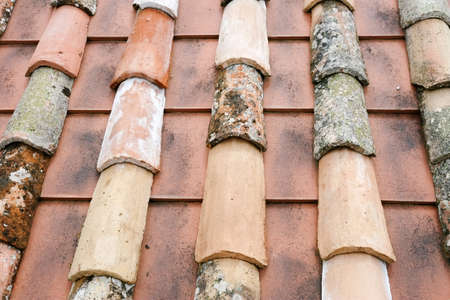 damaged roof: Old tiles and clay roof tiles Stock Photo