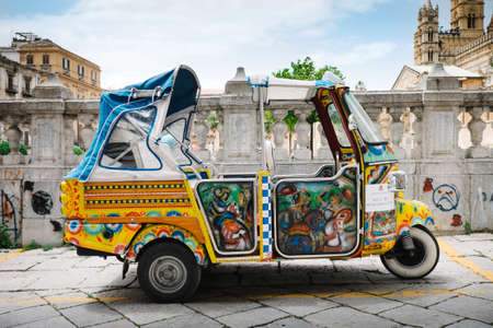 palermo   italy: Palermo, Italy - May 12, 2016: Taxi for tourists parked near the Cathedral of Palermo.