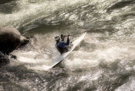 canoeist: Canoeist in the rapids of the river Stock Photo
