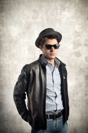 Young stylish man with hat and sunglasses Stock Photo