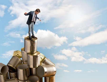 tin cans: Business man balancing on the tin cans
