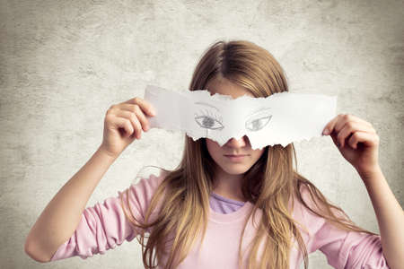 dissimulation: Teen girl whit paper mask