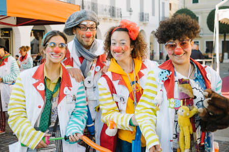 adams: Cittadella Padua, Italy - October 26, 2014: group of people dressed as clowns in the streets to promote therapy Patch Adams in pediatric hospitals