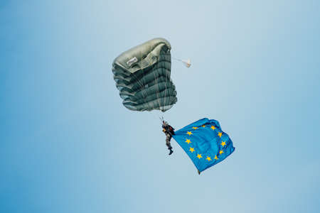 airpower: Zeltweg, Styria, Austria - September 3, 2016: Parachutist who hovers in the air with the European  flag on international event AIRPOWER16 Editorial