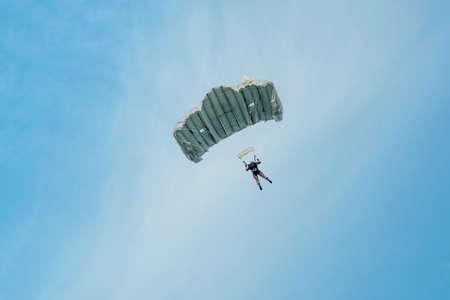 airpower: Zeltweg, Styria, Austria - September 3, 2016: Parachutist who hovers in the air  flag on international Air Show AIRPOWER16