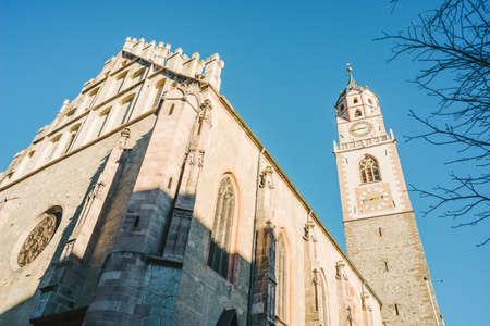 Bell Tower of the Cathedral of Merano - Italy  Detail of the bell tower of the Cathedral of St. Nicholas (1302-1465) in Merano, Bolzano, Trentino Alto Adige, Italy