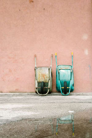 wheelbarrows leaning against the wall Stock Photo