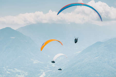 Monte Avena Feltre, Italy - July 5, 2017 :  Pilots who took off during 15th Fai Paragliding World Championship.