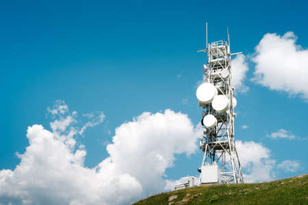 Telecommunication tower with many antennas and repeaters Stockfoto