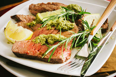Cut beef served with Genoese pesto, spices, rosemary and lemon