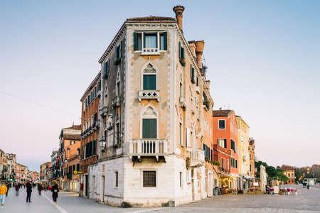 Venice, Italy - people walking in Via Garibaldi crossing with seven martyrs shore 写真素材