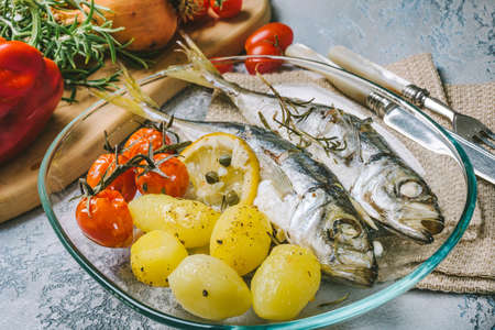 Mackerel cooked in the oven with potatoes and cherry tomatoes
