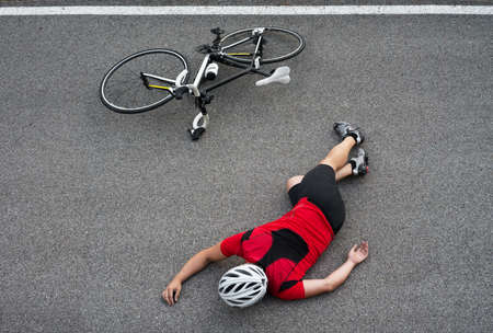 the unconscious: Unconscious cyclist in the road