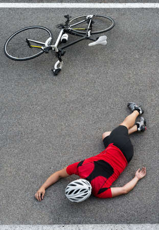 knocked out: Cycle accident in the road vertical space for text
