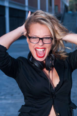 shouting girl: urban shouting girl with earpieces