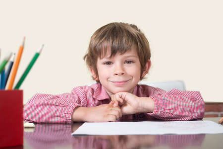 scholastic: scholastic boy in class watching to camera Stock Photo