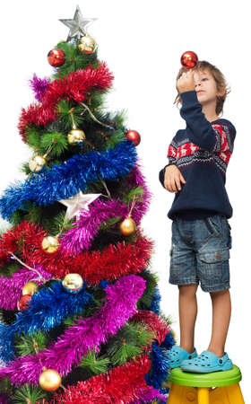 decorating christmas tree: Boy decorating Christmas tree isolated