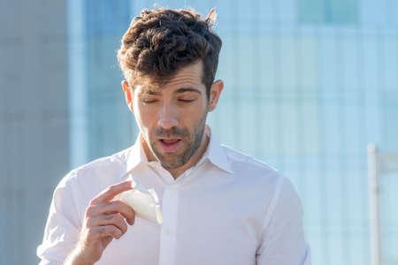 handkerchief: Man with handkerchief sneezes