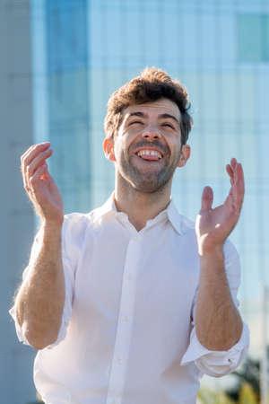 surpass: Young Man celebrate winning aplause