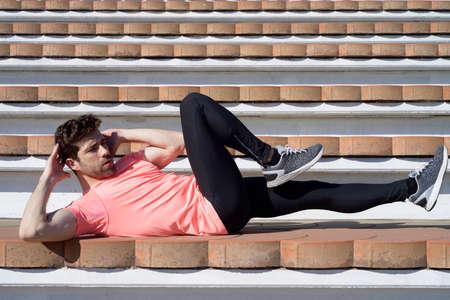 sportman: sportman warming and stretching fallen down