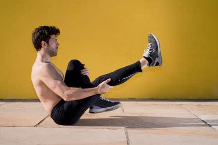 sportman: sportman warming and stretching