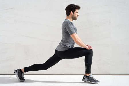 quadriceps: Man stretching quadriceps