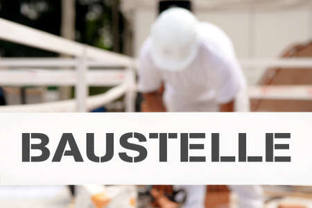 reconstruct: Man working behind of tape wiht baustelle