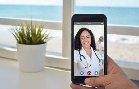 smartphone video call to talk to doctor woman