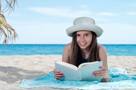 cheerfull: girl on the beach with book Stock Photo