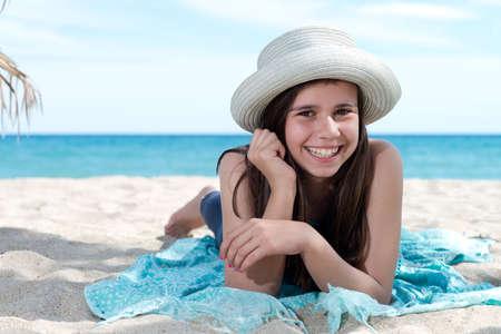 cheerfull: Happy girl lying on the beach