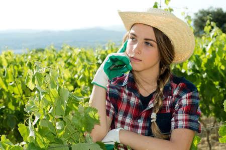 looking around: handsome girl farmer looking around