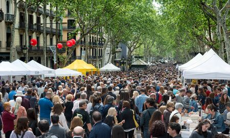 Barcelona, ??Spain_04 / 23/2018: many people visit the rambles during saint george day