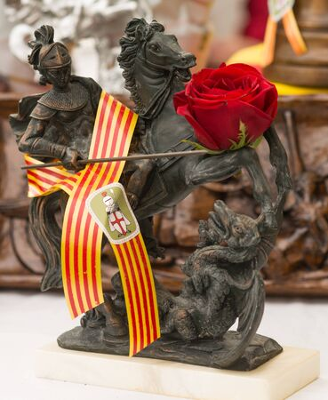 Barcelona, ??Spain-04/23/2018: Figure of Saint George and dragon with rose Editorial