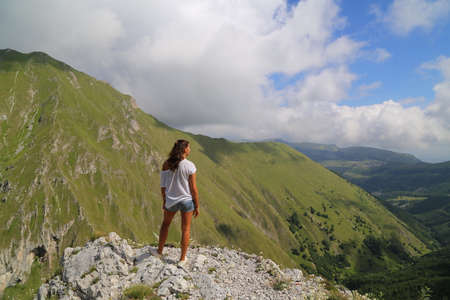Young lady on the top of a mountain Stock Photo