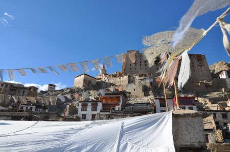 tibetan house: Leh palace with prayer flags Stock Photo