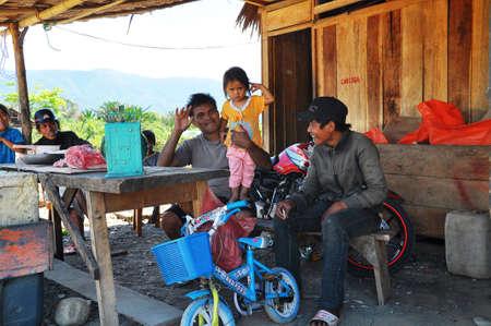 beggary: Unidentified people work on the street in Bira Editorial