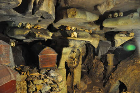 toraja: Lemo (Tana Toraja, South Sulawesi, Indonesia), famous burial site with coffins placed in caves carved into the rock, guarded by balconies of dressed wooden statues, images of the dead persons