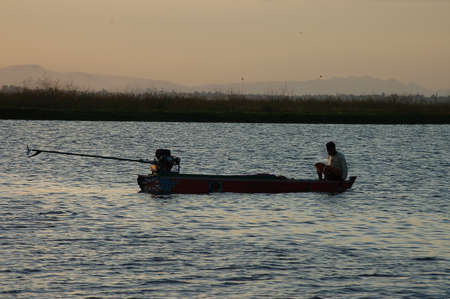 indigence: Unidentified people work on the river at Singkang