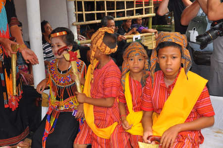 costum: Group Portrait of Torajan girls at a funeral ceremony