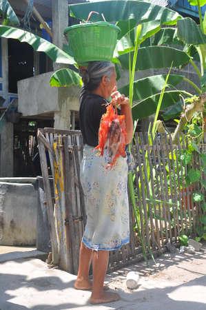destitution: Unidentified people work on the street in Bira Editorial