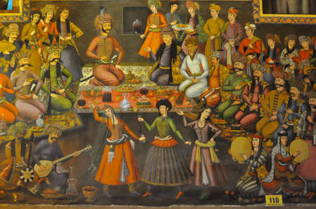 Dinner with belly dances in the king palace on the wall fresco in palace Chehel Sotoun Editorial