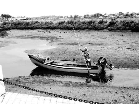 Man nagivates through shallow water.                               photo