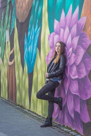 southern european: Young woman in urban landscape - graffiti