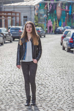 southern european: Beautiful girl in a photo shoot in the city