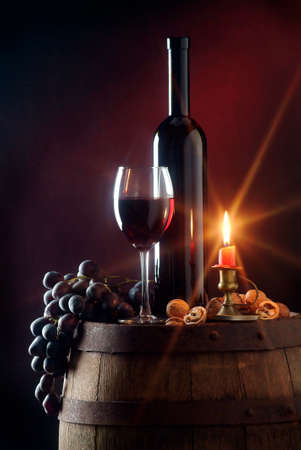 barell: wine bottle candle bunch of black grapes