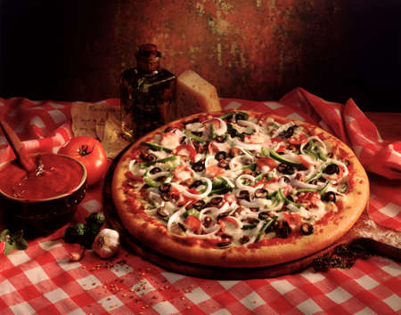 pizzas: fresh pizza with mushrooms and herbs in olive oil Stock Photo