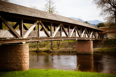 moutains: Wood and stone made bridge over an river, with the moutains in background